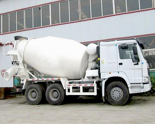 Concrete transporting and mixing truck